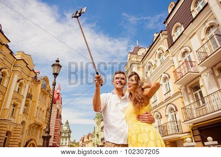 Couple In Love Making Selfie Photo On Self Stick