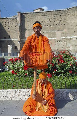 Street Actors Costumed As Indian Yogi