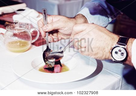 Chef is cooking tuna appetizer, toned image poster