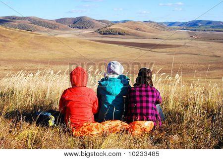 Girls in autumn landscape