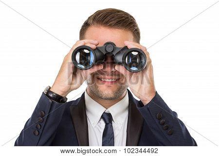 Businessman Smiling While Using A Binocular