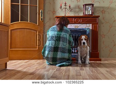 Woman With  Dog Near A Fireplace
