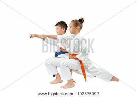 Children are beating the blow gyaku-tsuki in racks of karate