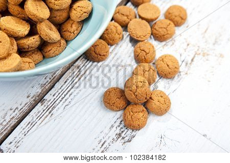 Dutch Candy Pepernoot With Bowl On White Wooden Background