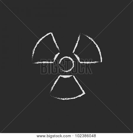 Ionizing radiation sign hand drawn in chalk on a blackboard vector white icon isolated on a black background.