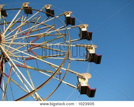 Ferris Wheel Against The Blue
