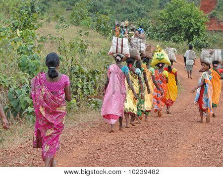 Women Carry Goods On Their Heads