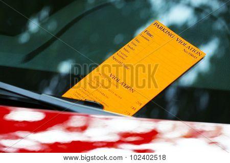 Parking violation ticket on car windscreen poster