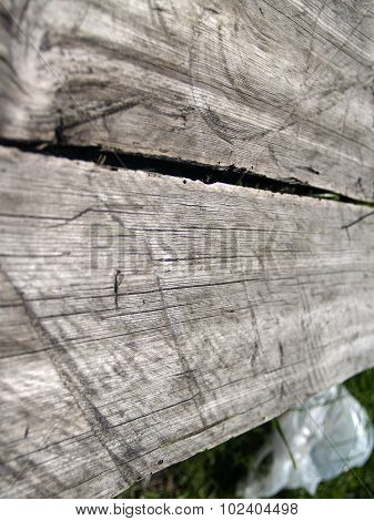 The weathered wooden planks background with cracks