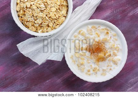 Porridge With Milk And Brown Sugar And Raw Rolled Oats