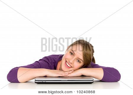 Girl leaning on a laptop