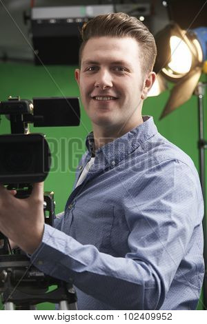 Portrait Of Cameraman Working In Television Studio poster