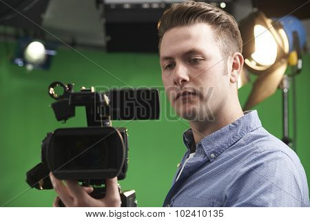 Cameraman Working In Television Studio