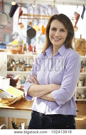 Owner Of Homeware Shop Standing In Store