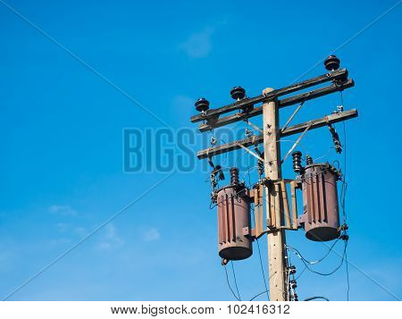 Old Transformers On Concrete Pole With Blue Sky