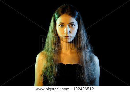 Beautiful Young Woman In Blue And Yellow Lights