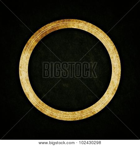 Ancient golden ring on abstract texture background