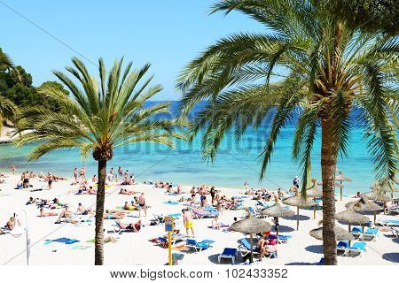 Mallorca, Spain - May 28: The Tourists Enjoiying Their Vacation On The Beach On May 28, 2015 In Mall