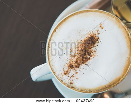 Vintage Tone Of Cup Of Hot Capuchino Coffee On The Brown Table