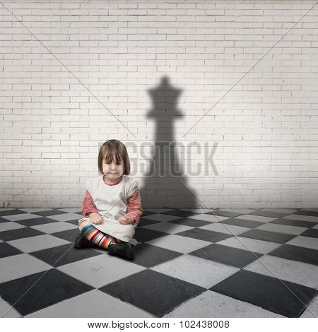 little girl with queen shadow on a checkered floor