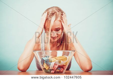 Diet. Girl With Colorful Measuring Tapes In Bowl
