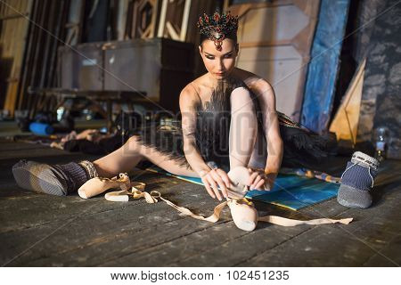 Ballerina sitting on the warm-up backstage