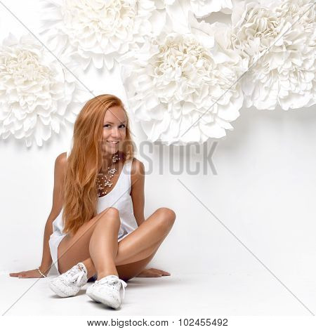 Beautiful Fashion Redhead Woman Sitting Neat Wall With Big Flowers