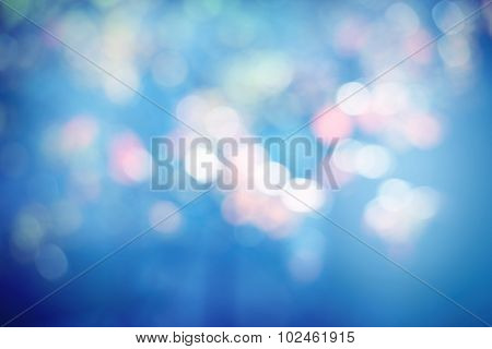 Blue Lights Festive background. Abstract holiday twinkled bright background with natural bokeh