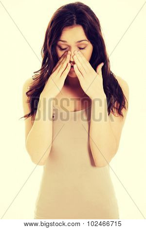 Young woman suffering from sinus pressure pain. poster