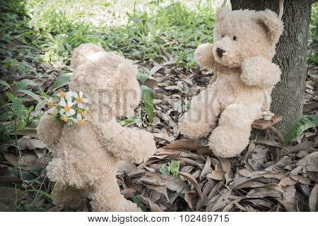 Teddybears at the park, with fresh flowers