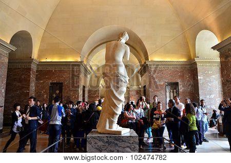Paris, France - May 13, 2015: Tourists Visit The Venus De Milo Statue At The Louvre Museum
