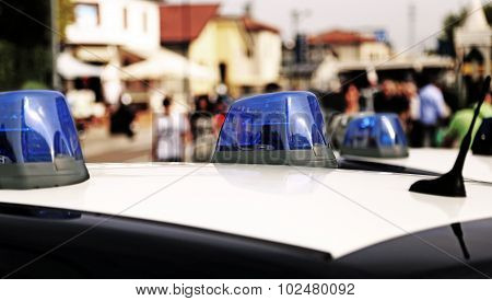 Police Car While Patrolling In The City