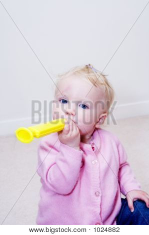 Baby Playing Toy Flute