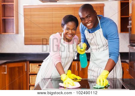 young african american couple cleaning together in the kitchen