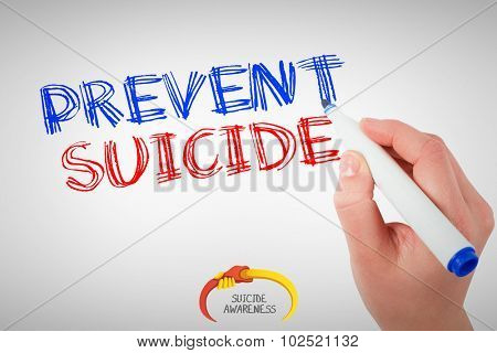 Businesswomans hand writing with marker against suicide awareness