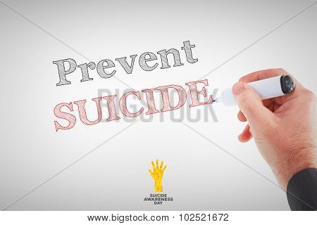 Businessmans hand writing with marker against suicide awareness day