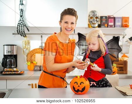 Girl In Halloween Bat Costume Spending Time With Mother
