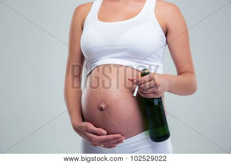 Pregnant woman with beer and cigarette isolated on a white background