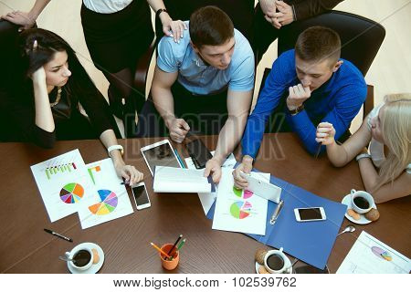 Top View Of A Group Of Young People At A Business Meeting Schedules