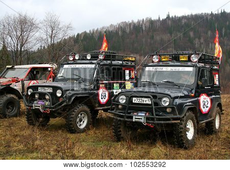 MINYAR, RUSSIA - OCTOBER 31: Competitors' off-road vehicles UAZ take part at the annual trophy challenge