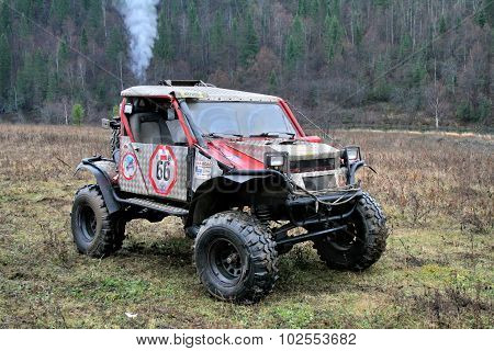 MINYAR, RUSSIA - OCTOBER 31: Off-road vehicle No. 66 takes part at the annual trophy challenge