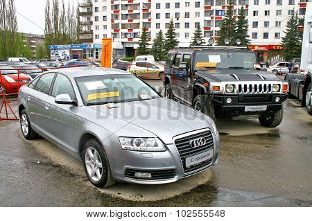 UFA, RUSSIA - MAY 11: Used cars Audi A6 and Hummer H2 exhibited at the annual Motor show