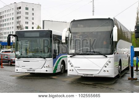 UFA, RUSSIA - MAY 11: Coach NEFAZ 52999 (VDL Mistral) and city bus NEFAZ 52998 (VDL Transit) exhibited at the annual Motor show