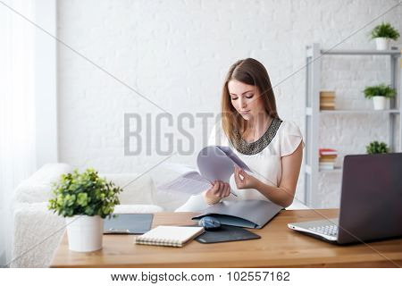 businesswoman with laptop and diary concept freelance work at home, planning, scheduling