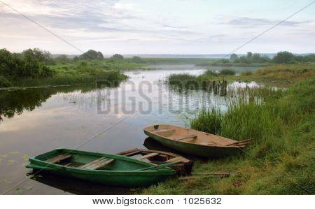 Boats Beside Riverside Matutinal Landscape