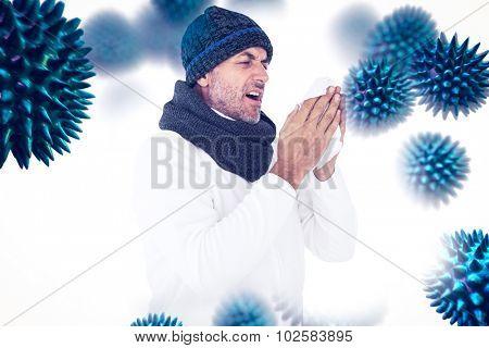Sick man in winter fashion sneezing against virus