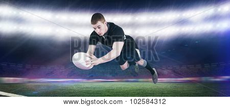 A rugby player scoring a try against rugby stadium