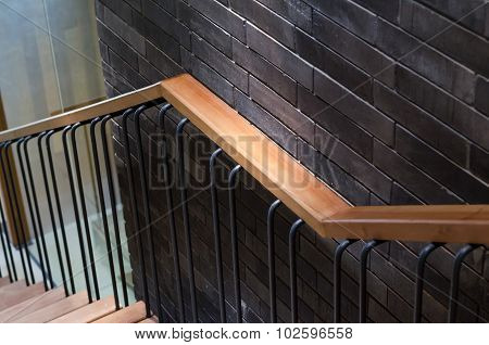 Wooden Handrail With Brick Wall