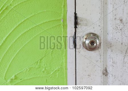 Vintage Knob Door On Green Cement Wall Can Be Used For Background