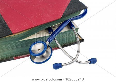 book and stethoscope, symbol photo for bungling, doctors mistakes and expertise